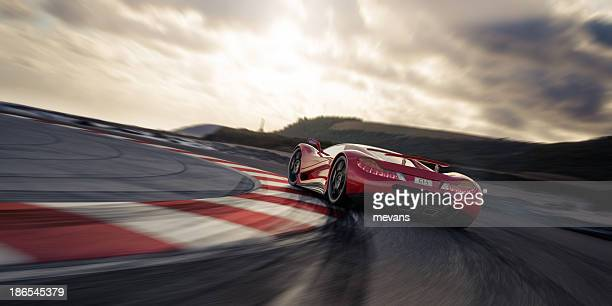 red sports car on a racetrack - motorsport stock pictures, royalty-free photos & images