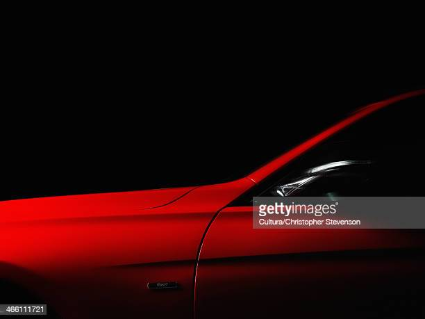 red sports car - muscle car stock photos and pictures