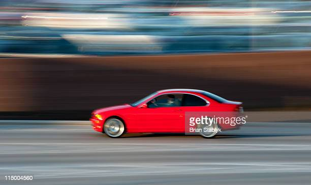 Red Sports Sedan, Blurred Motion