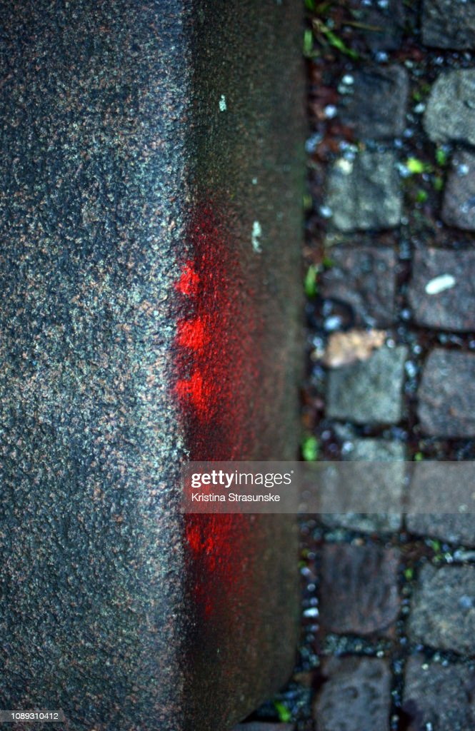 Red Spray Paint On An Asphalt Stock Photo - Getty Images