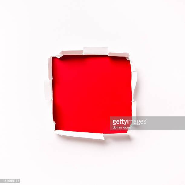 Red square shaped hole in the white paper
