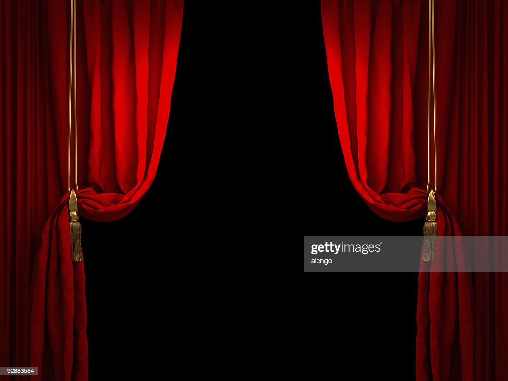 Red stage curtain drawn back with golden ropes : Stock Photo