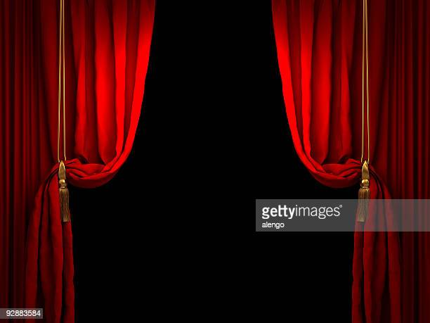 Red stage curtain drawn back with golden ropes