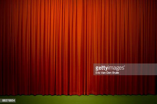 red stage curtain - eric van den brulle stock pictures, royalty-free photos & images