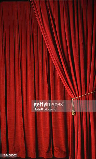 Red stage curtains at a theater