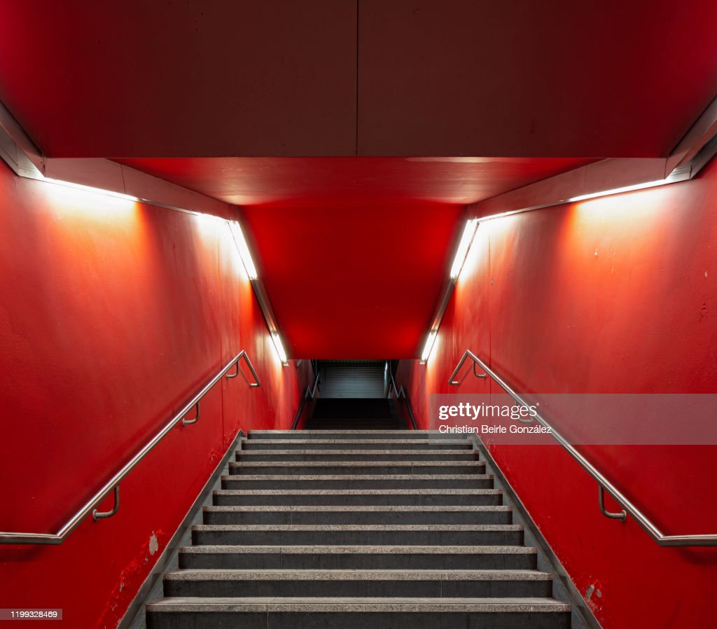 Red staircase of the exit of the S-Bahn station Trudering, Munich, Germany : Stock Photo
