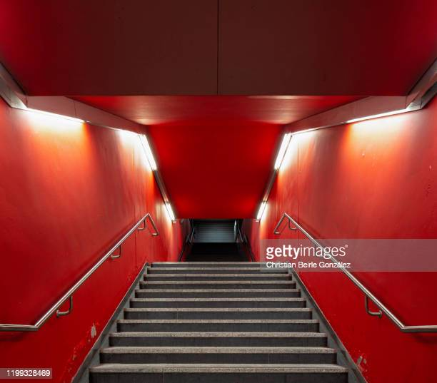 red staircase of the exit of the s-bahn station trudering, munich, germany - christian beirle gonzález stock pictures, royalty-free photos & images