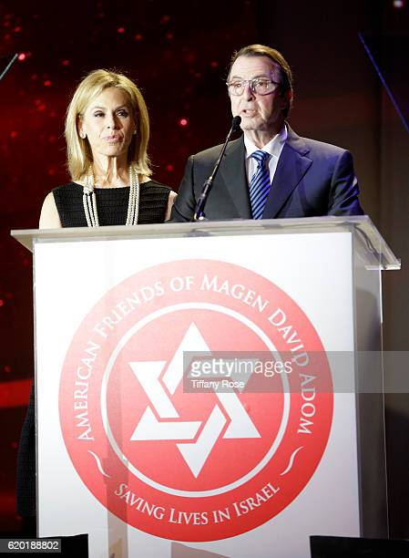Red Star Ball Hosts Adele Alagem and Beny Alagem speak onstage during the American Friends Of Magen David Adom's Red Star Ball at The Beverly Hilton...