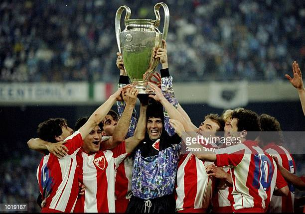 Red Star Belgrade celebrate with the trophy after their victory in the European Cup final against Marseille on May 29, 1991 in Bari, Italy.