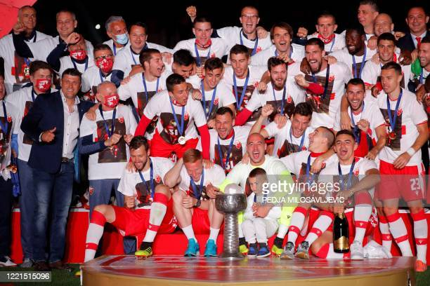 Red Star Belgrade players celebrate their third successive and record-extending 31st league title after the last match of the season, between FC...