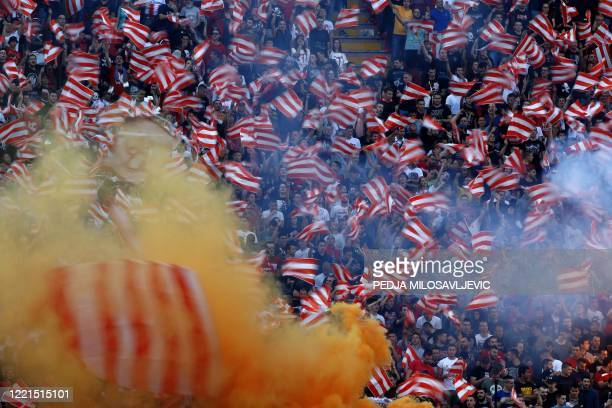 Red Star Belgrade supporters celebrate their team's third successive and record-extending 31st league title during the last match of the season,...