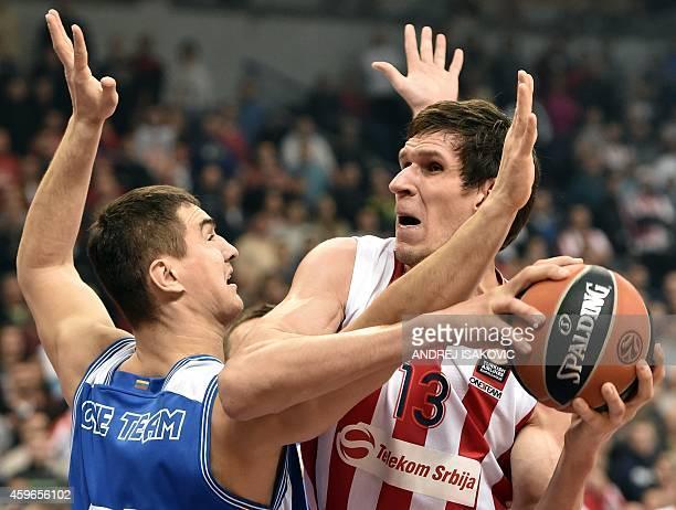 Red Star Belgrade's center Boban Marjanovic vies with Neptunas Klaipeda's forward Simas Galdikas during the Euroleague basketball match Crvena Zvezda...