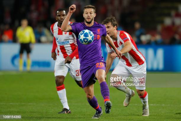 Red Star Belgrade's Comorian forward El Fardou Nabouhane and Red Star Belgrade's Montenegrin defender Filip Stojkovic vie for the ball with...