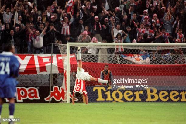 Red Star Belgrade's Goran Drulic celebrates as Leicester City's Andy Impey looks on