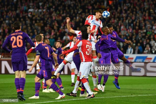 Red Star Belgrade's Serbian forward Milan Pavkov heads the ball and scores a goal during the UEFA Champions League Group C secondleg football match...