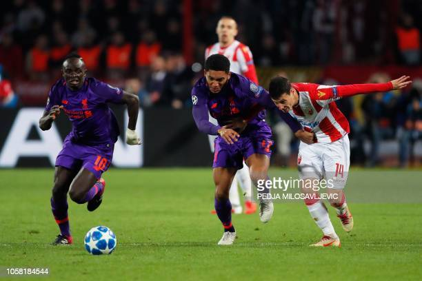 Red Star Belgrade's Serbian forward Slavoljub Srnic vies for the ball with Liverpool's Senegalese midfielder Sadio Mane and Liverpool's English...