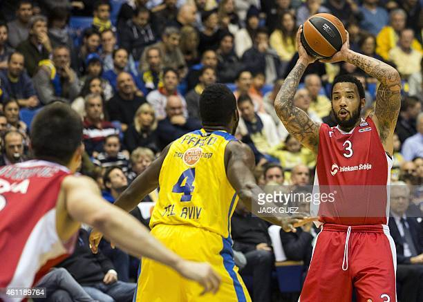 Red Star Belgrade's US guard Marcus Williams vies with Maccabi Electra Tel Aviv's US guard Jeremy Pargo during their Euroleague Top 16 basketball...