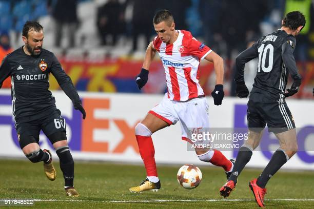 Red Star's Aleksandar Pesic fights for the ball with CSKA's Bibras Natcho and CSKA's Alan Dzagoev during the Europa League Round of 32 first leg...