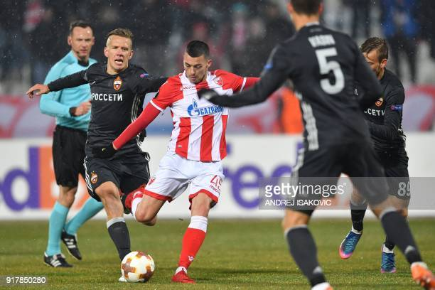 Red Star's Aleksandar Pesic fights for the ball with CSKA's Pontus Wernbloom during the Europa League Round of 32 first leg football match between...