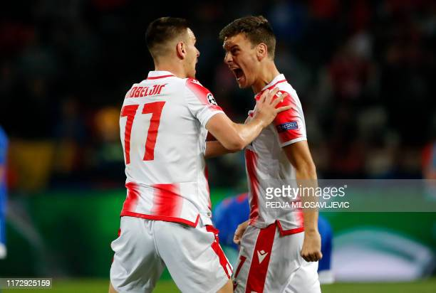 Red Stars Milos Vulic and Marko Gobeljic celebrate a goal during the UEFA Champions League Group B football match between Red Star Belgrade and...