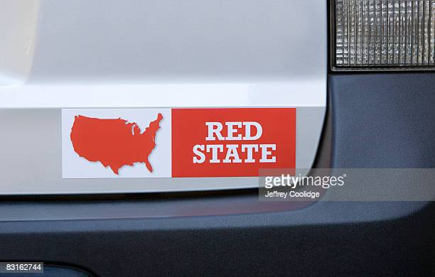 red state bumper sticker on car - bumper sticker stock photos and pictures