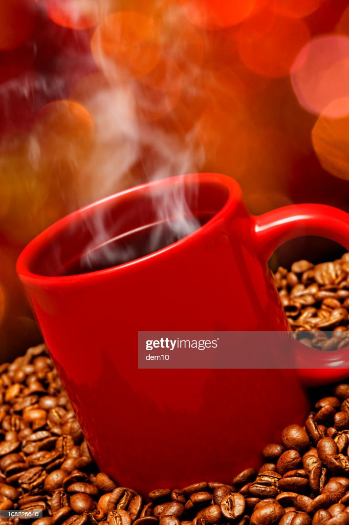Red Steaming Coffee Cup and Beans : Stock Photo