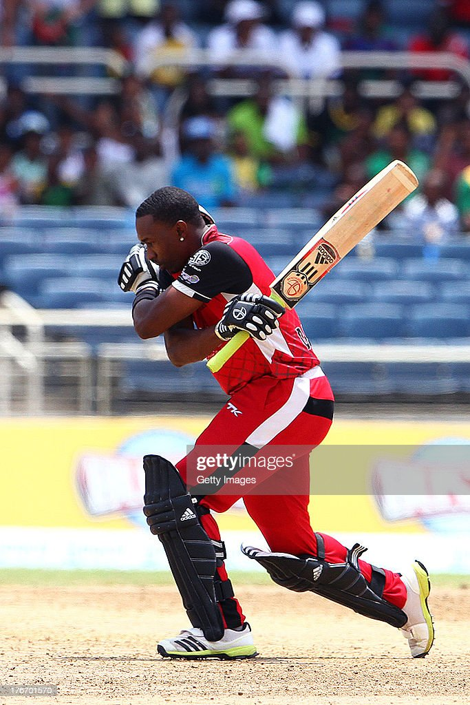 Red Steel captain Dwayne Bravo celebrates victory during the Eighteenth Match of the Cricket Caribbean Premier League between St. Lucia Zouks v Trinidad and Tobago Red Steel at Sabina Park on August 17, 2013 in Kingston, Jamaica.