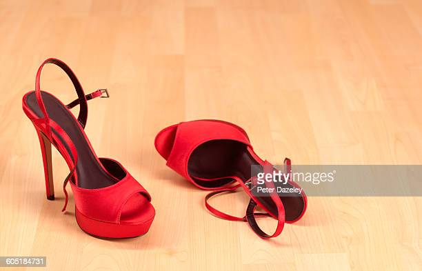 Red Stilettos on wooden floor