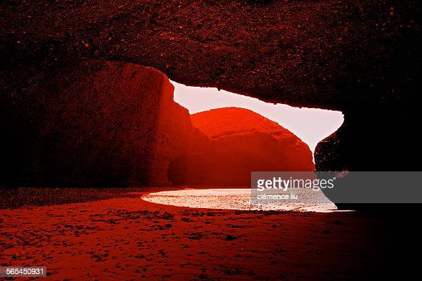 Red stone arches at Sidi ifni Morocco.