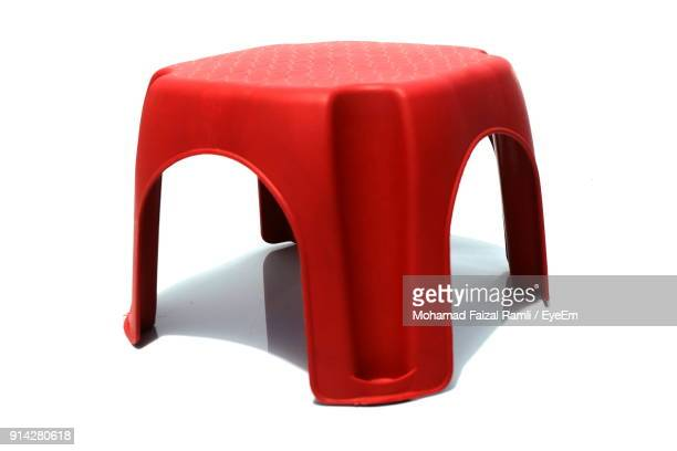 Red Stool Against White Background