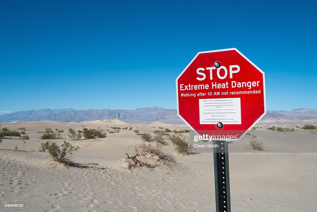 Red stop sign, Stove Pipe Dunes, Death Valley, California, USA : Stock Photo