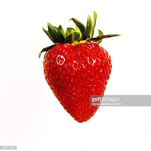 red strawberry on white background - strawberry stock pictures, royalty-free photos & images