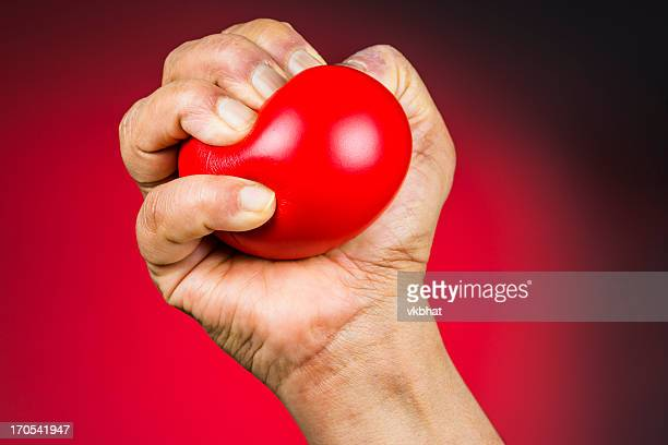 Red stress ball in hand
