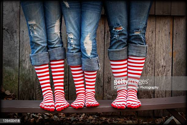red stripe socks legs - adjust socks stock pictures, royalty-free photos & images
