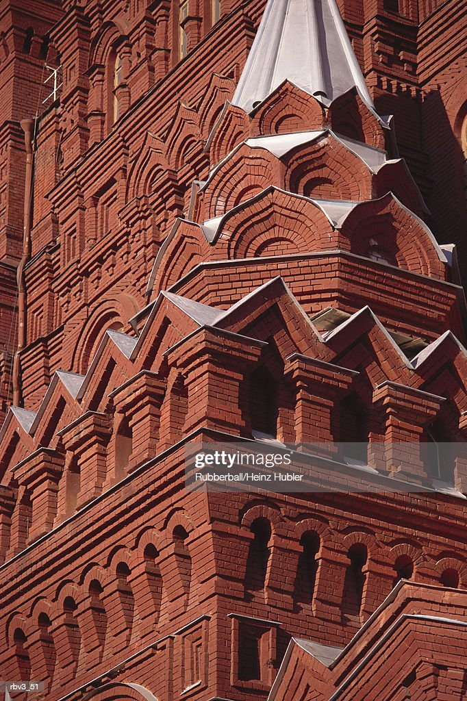 red stucco is used to cover intricately designed angles and arches of a vast building : Foto de stock