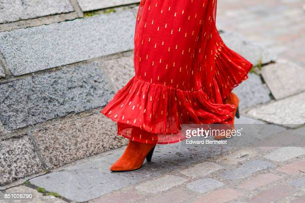 Red suede shoes are seen outside Preen by Thornton Bregazzi during London Fashion Week September 2017 on September 17 2017 in London England