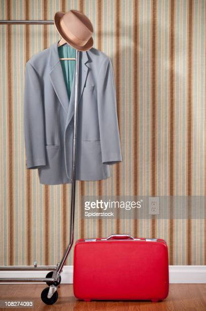 Red Suitcase With Coat And Hat