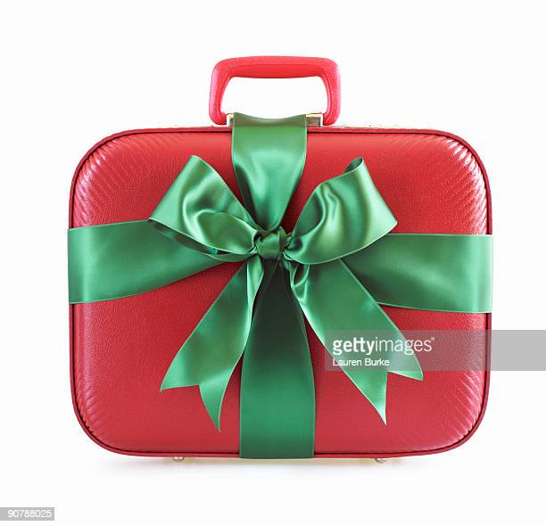 Red Suitcase Wrapped in Green Ribbon