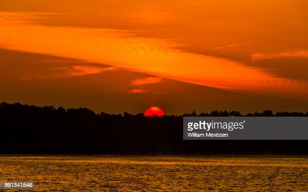 red sun - william mevissen stock pictures, royalty-free photos & images