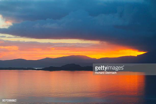 Red sunset over loch, taken from mainland Wester Ross, overlooking Raasay and Skye