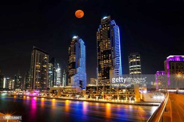 Red supermoon overlooks the Dubai Marina.