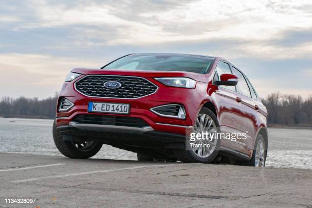 red suv ford edge on the road - ford motor company stock pictures, royalty-free photos & images