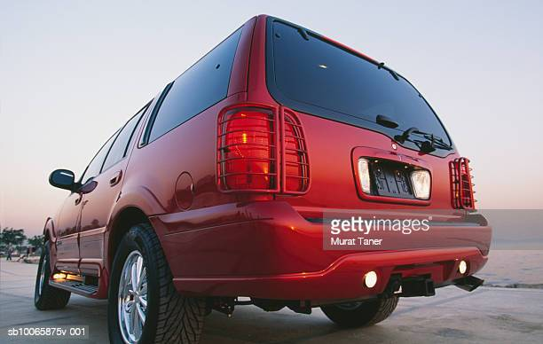 red suv near beach, rear view - 2000s style stock pictures, royalty-free photos & images