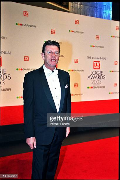 Red Symons arriving on the red carpet for the 45th Annual TV Week Logie Awards 2003 held at the Crown Casino Melbourne Australia