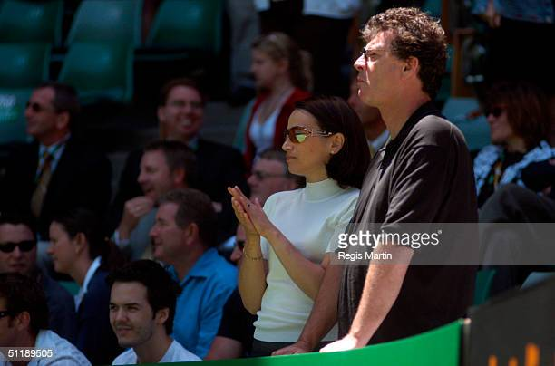 Red Symons Skyhooks guitarist songwriter and TV villain with his partner at the Rod Laver Arena for the ninth day of The Australian Tennis Open in...