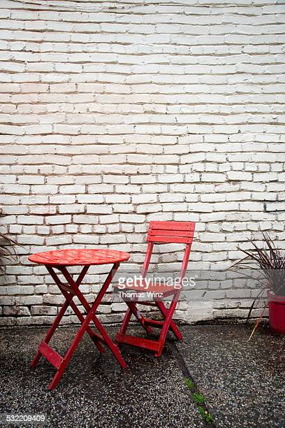 Red Table and Chair in the rain