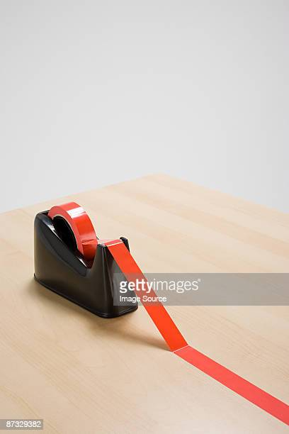 red tape on desk - tape dispenser stock photos and pictures