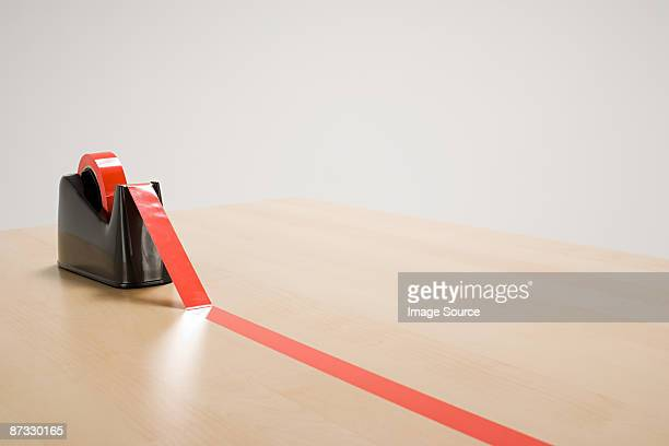 Red tape on desk