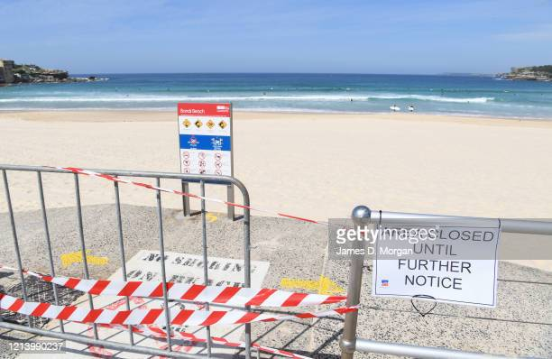 Red tape securing the beach at an empty Bondi beach after authorities banned people from gathering on it on March 22 2020 in Sydney Australia Prime...