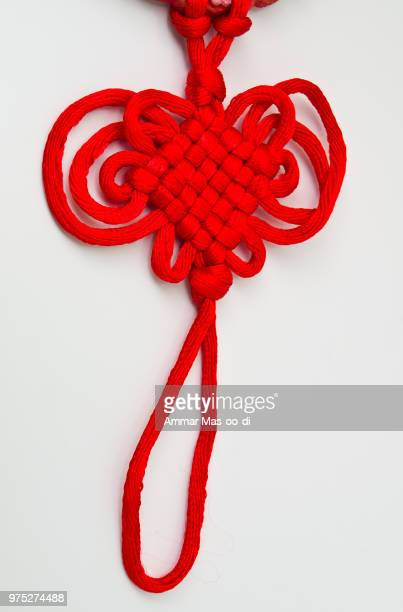 red tassel of china knot - a kind of adornment in festival - chinese knotting stock pictures, royalty-free photos & images